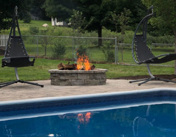 Fire Pit sitting beside the pool